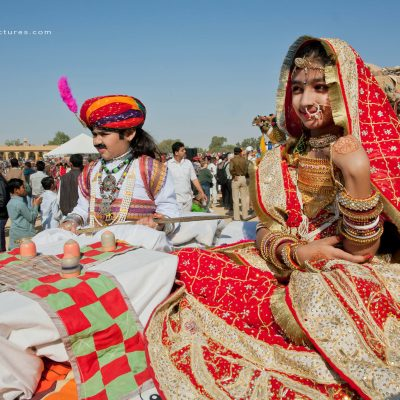Children in beautiful indian costumes going to carnival