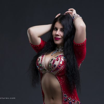 Young beautiful exotic eastern women in ethnic red dress